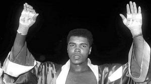 Cassius Clay celebrates his fifth round victory (PA)