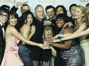 """the cast and crew of """"Glee,"""" posing with the award they won for Best Television Series - Comedy Or Musical at the Golden Globe Awards in Los Angeles, California, USA"""