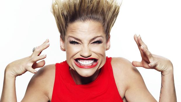 Former Girls Aloud singer Sarah Harding, 33, showing no airs and graces as her face is battered with a 270mph blast of wind blown in the world's first high speed selfie photo booth. Pic www.hashtag.co.uk
