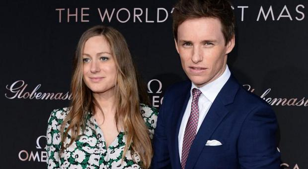 Family man: Eddie Redmayne with wife Hannah Bagshawe. Their daughter Iris was born earlier this year
