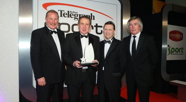 Gerry Armstrong receives his award from Pat Jennings, Billy Hamilton and John Maguire of Belleek Living