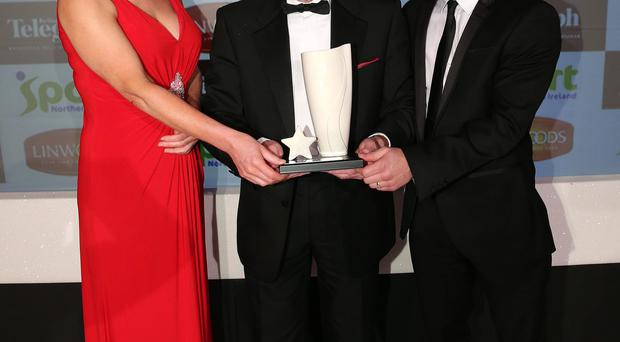 Winner: Billy McKee (centre) receives his Local Heroes award at the 2013 Belfast Telegraph Sports Awards from Carl Frampton and Sport NI Chief Executive Antoinette McKeown