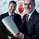 Inspiring: The 2013 Belfast Telegraph Sports Awards Hall of Fame inductee, Tyrone manager, Mickey Harte (right) with award sponsor, Belleek managing director, John Maguire