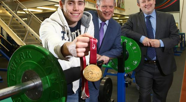 Golden moment: Sport NI-funded top athlete Jason Smyth, and the IPC World Championship 100m gold medal he won last month, with Sport NI Interim Chief Executive Arthur Scott and Belfast Telegraph Sports Editor Steven Beacom