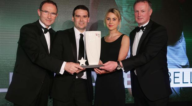 Fame game: David Healy receives his award from Rachael Weir (Belleek Living), Michael O'Neill and Martin O'Neill