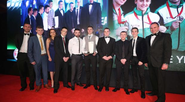 Knockout: Last year's Team of the Year, the NI Commonwealth Games Boxing Team of Paddy Barnes, Michael Conlon, Michaela Walsh, Sean McGlinchy, Steven Donnelly, Sean Duffy, Joe Fitzpatrick and Ruairi Dalton, receive their award from Chris Nelmes of The Outlet and Irish Davis Cup captain Conor Niland