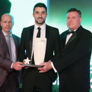 Best man: Conor McLaughlin receives his George Best Breakthrough Award from Brian Thornton (right), general manager Ramada Plaza Hotel, and Tyrone legend Peter Canavan