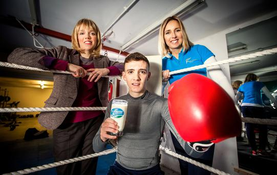 Boxing Day: Rising boxing star Brendan Irvine joined Caroline Martin (left) of Dale Farm and Gillian Hetherington of the Mary Peters Trust at his Belfast gym to announce the 2015/16 Dale Farm Athletes Academy winners