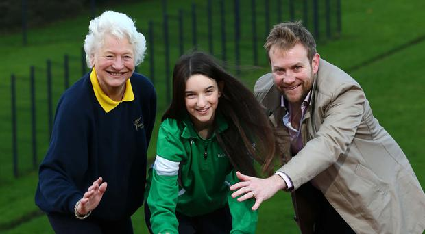 Having a ball : Dame Mary Peters and Stuart Carson from Rainbow Communications congratulate Eimhear Morris on receiving the Rainbow Communications Sports Award in partnership with the Mary Peters Trust