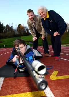 On target: Jack Magill with Stuart Carson and Mary Peters