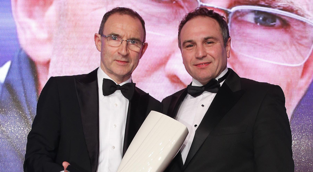 Worthy recipient: Hall of Fame inductee Martin O'Neill (left) with Chris Nelmes of sponsors The OUTLET Banbridge