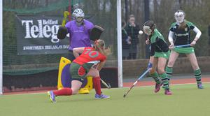 Mandatory Credit: Rowland White / PressEye Belfast Telegraph Schools' Cup Semi-Final Teams: Friends' School (red) v Sullivan Upper (green) Venue: Lisnagarvey Date: 11th February 2015 Caption: Rosie Henderson attacks and scores for Friends