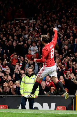 Manchester United's Spanish midfielder Juan Mata celebrates after scoring the opening goal of the EFL (English Football League) Cup fourth round match between Manchester United and Manchester City at Old Trafford in Manchester, north west England on October 26, 2016. AFP/Getty Images