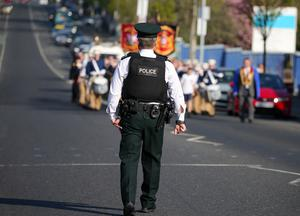 Press Eye - Belfast - Northern Ireland - 22nd April 2019  Apprentice Boys of Derry Easter Monday parade in Belfast.  A feeder parade makes its way to the main parade in east Belfast past the Ardoyne shops in north Belfast.  There was a small police presence compared to previous years where trouble has occurred in the area regarding parading.    Picture by Jonathan Porter/PressEye