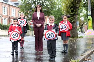 Infrastructure Minister Nichola Mallon with pupils from Currie Primary School and Holy Family Primary School at the launch of the roll out of the scheme