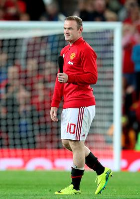 Thanks: Wayne Rooney speaks to the fans at Old Trafford last night