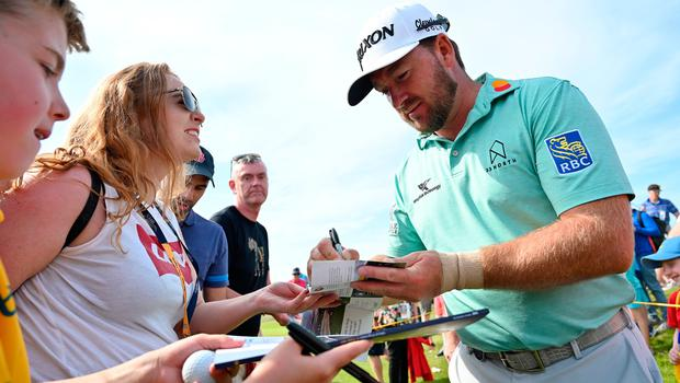 PORTRUSH, NORTHERN IRELAND - JULY 15: Graeme McDowell of Northern Ireland signs autographs during a practice round prior to the 148th Open Championship held on the Dunluce Links at Royal Portrush Golf Club on July 15, 2019 in Portrush, United Kingdom. (Photo by Stuart Franklin/Getty Images)