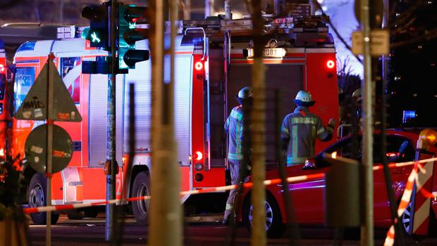 Rescue forces work at the site where a truck speeded into a christmas market in Berlin, on December 19, 2016 killing nine persons and injuring at least 50 people. / AFP PHOTO / Odd ANDERSENODD ANDERSEN/AFP/Getty Images