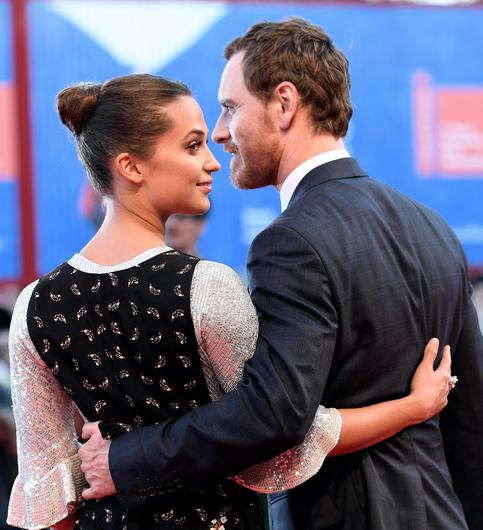 German-Irish actor Michael Fassbender and Swedish actress Alicia Vikander arrives for the premiere of 'The light between oceans' during the 73rd Venice Film Festival in Venice, Italy, Thursday, Sept. 1, 2016. (Ettore Ferrari/ANSA via AP)