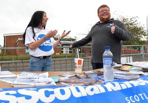 "GLASGOW, SCOTLAND - SEPTEMBER  18:   ""Yes"" activists campaigning in Castlemilk today as the people of Scotland take to the poles to decide their country's fate in a historic vote on September 18, 2014 in Glasgow, Scotland. After many months of campaigning the people of Scotland today head to the polls to decide the fate of their country.  The referendum is too close to call but a 'Yes' vote would see the break-up of the United Kingdom and Scotland would stand as an independent country for the first time since the formation of the Union.(Photo by Mark Runnacles/Getty Images)"