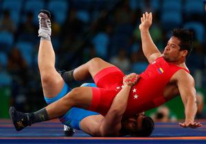 RIO DE JANEIRO, BRAZIL - AUGUST 15:  Erwin Jose Caraballo Cabrera of Venezuela and  Sabah Shariati of Azerbaijan compete during the Men's Greco-Roman 130 kg Repechage on Day 10 of the Rio 2016 Olympic Games at Carioca Arena 2 on August 15, 2016 in Rio de Janeiro, Brazil.  (Photo by Ryan Pierse/Getty Images)