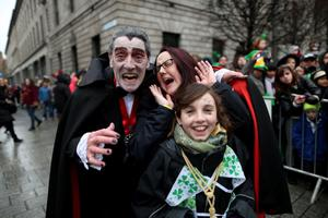 Erinna Behal and her niece Rosie Behal (10) meet 'Paddy Drac' during the St Patrick's day parade through Dublin city centre on St Patrick's day. PRESS ASSOCIATION Photo. Picture date: Sunday March 17, 2013. Photo credit should read: Julien Behal/PA Wire
