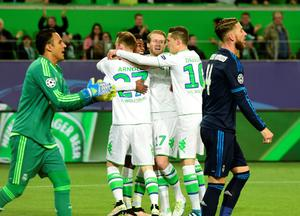 Wolfsburg's midfielder Maximilian Arnold, Wolfsburg's striker Andre Schuerrle, Wolfsburg's midfielder Julian Draxler celebrate after a penalty kick goal during the UEFA Champions League quarter-final, first-leg football match between VfL Wolfsburg and Real Madrid on April 6, 2016 in Wolfsburg, northern Germany.  / AFP PHOTO / John MACDOUGALLJOHN MACDOUGALL/AFP/Getty Images