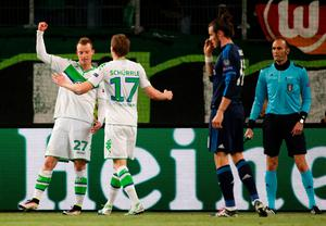 Wolfsburg's midfielder Maximilian Arnold (L) celebrates scoring the 2-0 goal with Wolfsburg's striker Andre Schuerrle during the UEFA Champions League quarter-final, first-leg football match between VfL Wolfsburg and Real Madrid on April 6, 2016 in Wolfsburg, northern Germany.  / AFP PHOTO / ODD ANDERSENODD ANDERSEN/AFP/Getty Images