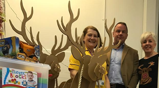 Jenne McDonald, head play specialist at the Children's Cancer Unit, alongside the ward receptionist, Michelle Kelly and Tom Smyth, owner of Dream Apartments.
