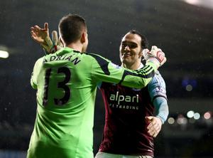 LONDON, ENGLAND - DECEMBER 18:  Adrian (13) and Joey O'Brien of West Ham United celebrate victory after the Capital One Cup Quarter-Final match between Tottenham Hotspur and West Ham United at White Hart Lane on December 18, 2013 in London, England.  (Photo by Paul Gilham/Getty Images)