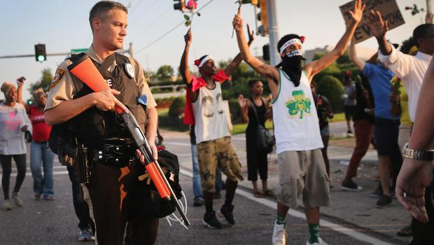 Demonstrators protest the killing of teenager Michael Brown on August 19, 2014 in Ferguson, Missouri. (Photo by Scott Olson/Getty Images)