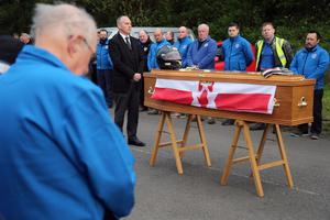 PACEMAKER, BELFAST, 27/4/2017: An Ulster flag is draped on the coffin of Dario Cecconi during a service at the start line on theTandragee 100 circuit in Co Armagh in his memory following his death in a crash at last Saturday's races. PICTURE BY STEPHEN DAVISON