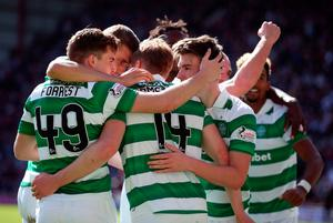 Celtic's Stuart Armstrong (centre) celebrates scoring his side's third goal of the game with team-mates during the Ladbrokes Scottish Premiership match at Tynecastle Stadium, Edinburgh. PRESS ASSOCIATION Photo. Picture date: Sunday April 2, 2017. See PA story SOCCER Hearts. Photo credit should read: Andrew Milligan/PA Wire. EDITORIAL USE ONLY