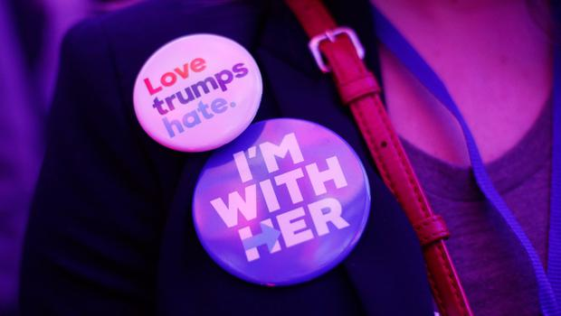 A guest with pro-Hillary Clinton badges attending the US Embassy's election night party in central London. PRESS ASSOCIATION Photo. Picture date: Tuesday November 8, 2016. Photo credit should read: Yui Mok/PA Wire