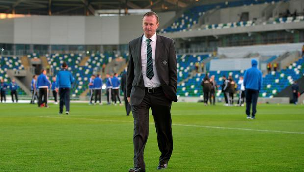 Northern Ireland manager Michael O'Neill inspects the pitch before Thursday evening's Euro 2016 Group F international football match at Windsor Park on October 8, 2015 in Belfast, Northern Ireland.  (Photo by Charles McQuillan/Getty Images)