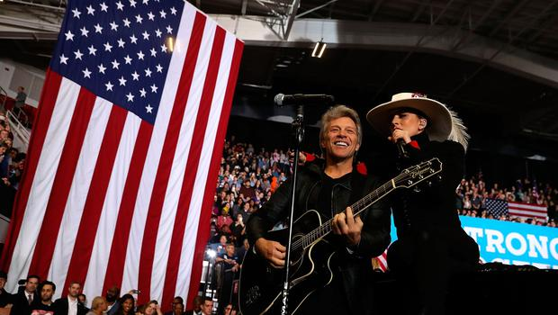 RALEIGH, NC - NOVEMBER 08:  Musicians Jon Bon Jovi (L) and Lady Gaga perform during a campaign rally with Democratic presidential nominee former Secretary of State Hillary Clinton at North Carolina State University on November 8, 2016 in Raleigh, North Carolina. The midnight rally followed Clinton campaigning in Pennsylvania, Michigan and North Carolina in the lead up to today's general election.  (Photo by Justin Sullivan/Getty Images)