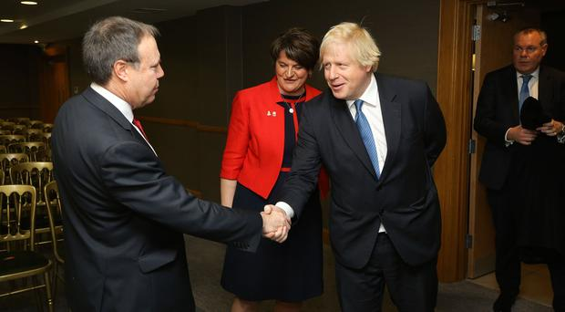 Boris Johnston MP is greeted at the DUP party conference by Leader Arlene Foster and Deputy leader Nigel Dodds MP pictured at the Crowne Plaza Hotel in Belfast. Photo by Kelvin Boyes / Press Eye October 2018.