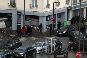 PARIS, FRANCE - JANUARY 09:  People are led away from the scene as Police mobilize with reports of a hostage situation at Port de Vincennes on January 9, 2015 in Paris, France. According to reports at least five people have been taken hostage in a kosher deli in the Port de Vincennes area of Paris. A huge manhunt for the two suspected gunmen in Wednesday's deadly attack on Charlie Hebdo magazine has entered its third day.  (Photo by Dan Kitwood/Getty Images)