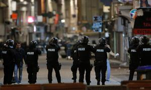Police forces prepare in St. Denis, a northern suburb of Paris, Wednesday, Nov. 18, 2015. Authorities in the Paris suburb of St. Denis are telling residents to stay inside during a large police operation near France's national stadium that two officials say is linked to last week's deadly attacks. (AP Photo/Christophe Ena)