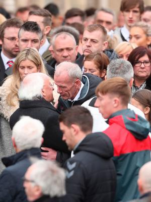 Michael D. Higgins, President of Ireland (centre left) at the funeral of Derry City football captain Ryan McBride at the Long Tower church in Londonderry, who was found dead at home on Sunday night aged 27. Niall Carson/PA Wire