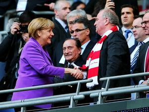 LONDON, ENGLAND - MAY 25:  German Chancellor Angela Merkel and Uli Hoeness President of Bayern Muenchen ahead of the UEFA Champions League final match between Borussia Dortmund and FC Bayern Muenchen at Wembley Stadium on May 25, 2013 in London, United Kingdom.  (Photo by Alex Grimm/Getty Images)