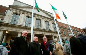 Sinn Fein's Martin McGuinness (left) alongside grandsons of James Connolly, one of seven signatories of the Proclamation, James Connolly (centre) and John Connolly following the first major event to mark the centenary of the 1916 Rising, at Dublin Castle in Ireland. PRESS ASSOCIATION Photo. Picture date: Friday January 1, 2016. Three flags which were flown on O'Connell Street during the rebellion were raised over Dublin Castle in the ceremony attended by President Michael D Higgins, Taoiseach Enda Kenny and Tanaiste Joan Burton. See PA story POLITICS Rising Ireland. Photo credit should read: Brian Lawless/PA Wire