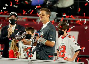 History man: Tom Brady enjoys the moment after Sunday's win