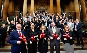 Staff at The Merchant Hotel celebrate after the AA upgraded its rating from five black stars to five red stars at the prestigious AA Hospitality Awards