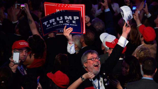 Supporters of Republican presidential nominee Donald Trump cheer during election night at the New York Hilton Midtown in New York on November 8, 2016.  / AFP PHOTO / JIM WATSONJIM WATSON/AFP/Getty Images