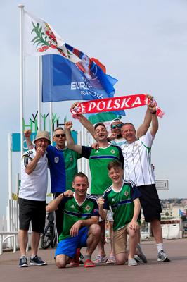 Northern Ireland fans are joined by a Polish football fan as they arrive on the seafront near Promenade des Anglais, Nice, France. PA