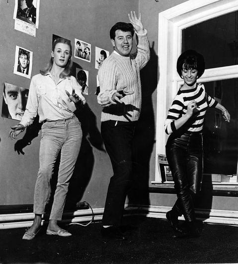 """Brendan Bowyer does """"The Fly"""" with two dancers who will be touring with the Rpyal Showband.  22/4/1966"""