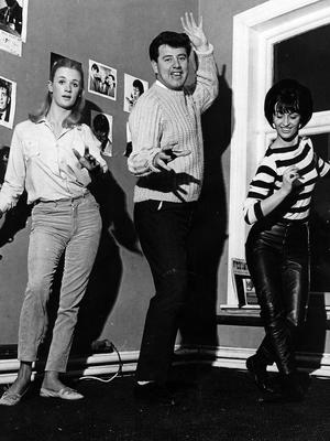 "Brendan Bowyer does ""The Fly"" with two dancers who will be touring with the Rpyal Showband.  22/4/1966"