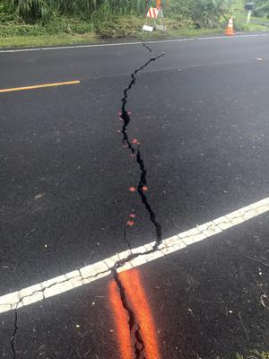 The road cracked after the eruption (Shane Turpin via AP)