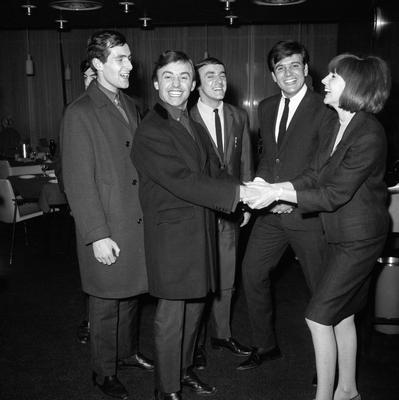 Gerry and the Pacemakers are welcomed back by Cilla Black and Billy J Kramer (both on right) when they arrived in London from their American tour in 1964. PA Wire.